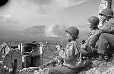 """""""The heavy Allied assault on Cassino was witnessed in the early stages by American Red Cross nurses who made a strictly off duty visit to the ruined town of Cevaro,"""" March 15 1944."""