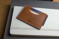 Our Card Case Slide is finely crafted with cowhide leather and contrast…