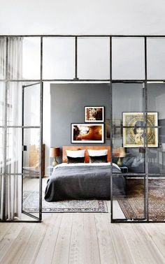Beautiful and Practical: Windows Indoors | Apartment Therapy: It's sort of a genius solution; a wall of windows clearly delineates separate spaces, but still lets light (and views) flow through. And if you need a little privacy, you can always install a curtain behind the windows, as in the photo above. It's the best of all possible worlds.