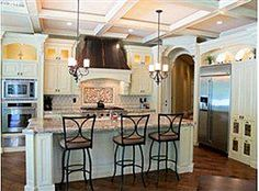 My someday kitchen... I love the ceiling detail, the back splash and the dark floor to the cream cabinet contrast. The lighting above the cabinetry is a must!