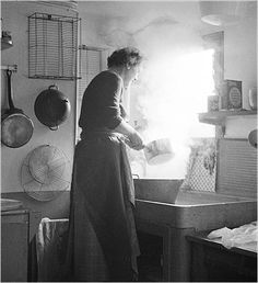 American author of the first comprehensive cookbook on French cooking in English, for an American audience, and later celebrity cook, Julia Child in her Paris kitchen.
