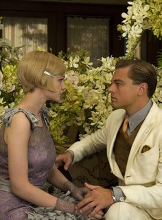 Carey Mulligan as Daisy Buchanan and Leonardo DiCaprio as Jay Gatsby in The Great Gatsby (2013).