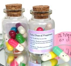 These are super cute! I like this idea.  Kawaii Happy Pill Gift - Cute Message in a Bottle - Happy Face Pills - Miniature greeting card stationary