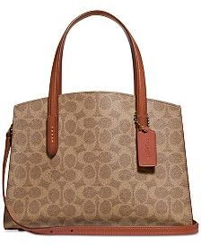 Designer-chic and ready for anything that comes its way. The COACH Coated Canvas Signature Charlie 28 Carryall features a lovely all-over signature print while gold-tone hardware accents and contrast trim add the perfect finishing touches. Kate Spade Handbags, Chloe Handbags, Lv Handbags, Popular Handbags, Handbags Online, Trendy Handbags, Luxury Handbags, Fashion Handbags, Designer Handbags