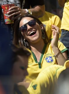 Gabriella Lenzi, the girlfriend of Brazil's forward Neymar, attends the round of 16 clash between Brazil and Chile. Neymar, The Girlfriends, Fifa World Cup, Fashion Quotes, Brazil, Round Sunglasses, Fashion Trends, Chile, Board