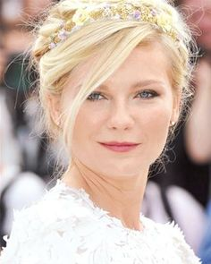 The key to making a romantic headband more boho and less bridal? Push it slightly back on your head with an undone updo like Kirsten Dunst's. Twist hair back into a bun with messy pieces left loose around your face.