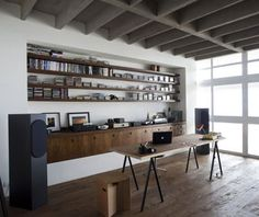 beautiful natural wood office with wood and metal table, exposed beam ceiling, built in and recessed shelves and cupboards