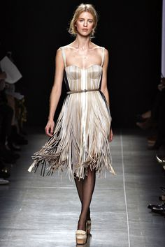A dolce vita silhouette brought bang up to date with silk fringing in the dreamiest, creamiest palette.