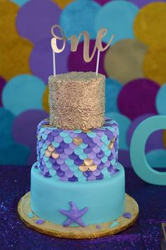The birthday cake at this 1st birthday Mermaid party is so cute!! See more party ideas and share yours at CatchMyParty.com #catchmyparty #partyideas #mermaidbirthdayparty #1stbirthdayparty #girl1stbirthdayparty #underthesea #mermaid
