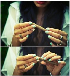 love her finger tat, nailpolish, lipstick and that she is rolling a blunt. pretty much just love her.