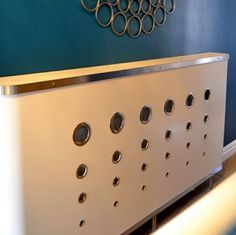 Get a retro look with this eyelet design white radiator cover. The soft curved edging and funky geometric design will turn your drab radiator into something spe...