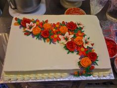 sheet cake with butter-cream floral spray. Nice with the right flowers and colors.