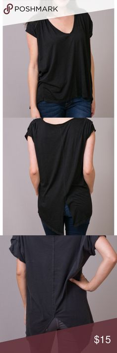 KNOT SISTERS PLUNGE TEE BLACK SHIRT WOMENS MEDIUM This black Plunge Tee basic shirt by Knot Sisters is the perfect, easy item to pair with some dark wash fitted jeans or your favorite pair of leggings for the cooler seasons. The slightly oversized short sleeved top has a v-neck and an open slit that starts mid way down the back for a cute pop of detail. Made of 55% cotton and 45% polyester. Machine wash with cold water and tumble dry on low. knot sisters Tops Tees - Short Sleeve