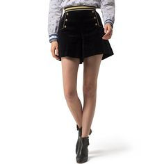 Tommy Hilfiger women's short. Hilfiger Collection, Fall 2016. As seen on the runway, these luxe shorts are beautifully styled in velvet adorned with golden buttons and trim. The flared hems give them a swingy, skort effect. • Classic fit, high waist.• 98% cotton, 2% spandex. • Gold banded trim, buttons at hips.• Dry clean. • Imported.
