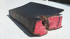 The Bible carried by Kurt Geiler which stopped shrapnel (WWII)
