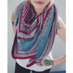 Playing with color and texture it knits up into an airy, yet cozy, shawl with a long wingspan.
