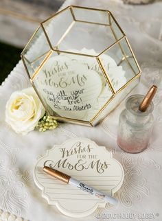 Use a terrarium to add instant style to your guest book table! Wishes to both the Mrs.