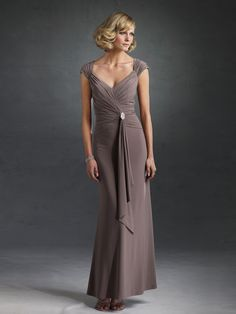 Mother dress with gathered cap sleeves and  jewel brooch embellishment cascading side   drape