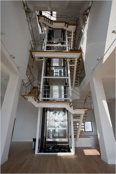 A beautiful staircase with glass elevator in a penthouse apartment listed at 25 million dollars in Brooklyn, NY. Stair Elevator, Elevator Design, Glass Elevator, Elevator Lobby, Tower Apartment, Brooklyn Apartment, Penthouse Apartment, York Apartment, Building Elevation