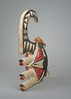 """Africa   """"Yam Knife"""" mask from the igbo peoples (Afikpo group) of the Cross River region in Nigeria   19th - 20th century   Wood, pigment, kaolin, raffia"""