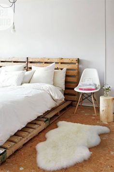 A DIY wooden headboard lends a nature-inspired look to a bedroom—which is contrasted by adding the glamour of a fur rug or throw blanket.