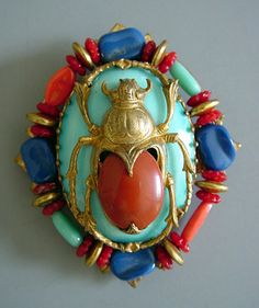 "HASKELL Egyptian scarab motif aqua, blue and orange 2-5/8"" brooch designed by Larry Vrba circa 1972-4. Larry says thousands of these were made because this was an extremely well-received group which stayed in the line for about 2 years due to it's popularity. That is a long time, as many pieces from that era were only sold for one season"
