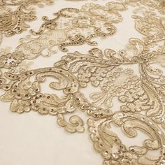 Vivian CHAMPAGNE Polyester Embroidery with Sequins on Mesh Lace Fabric by the Yard for Gown, Wedding, Bridesmaid, Prom - 10003 Stand out magnificently as you gracefully appear wearing this stunning lace fabric. Intricate embroidery adorns this fabric, with some sequins scattered all