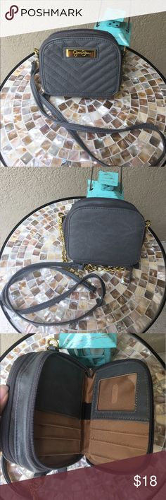 """🆕Jessica Simpson Tech Crossbody This fun and functional crossbody is perfect for your needs!!! Jessica Simpson grey crossbody bag has a part chain strap with a drop of 22.5"""", two sides zipper open to handy compartments- one side has place for your cards, ID, cash, even a mini pen or stylus spot! The other side opens up to more slots for any needs and a removable zippered pouch! Only used once - EUC ✅I ship same or next day ✅Bundle for discount Jessica Simpson Bags Crossbody Bags"""