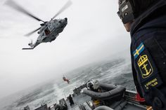 BALTIC SEA, May 30. 2017. A crew member is winched from a Swedish Armed Forces helicopter NH90, on the quarter deck of HSWMS Vinga  as it conducts a Passing exercise with Standing NATO Mine Countermeasures Group One vessels . NATO Photo by FRAN CPO Christian Valverde.