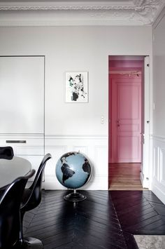 Ignore the pink but look at the contrast with the dark floors, white walls and pops of color. Its clean while adding vibrance and personality.