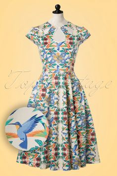 This 50s Mandala Swing Dress is simply perfect! The sun in shining, the birds are whistling and you're walking through the park wearing this beauty... picture perfect! The stunning flower and hummingbird print will simply take your breath away. The fitted bodice features an elegant keyhole with button, leaf shaped cut-outs and adorable cap sleeves. The full swing skirt is super flattering and gives you an amazing feminine silhouette. Made from a sturdy yet supple ivory white cott...