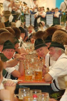 "October Festival Munich, ""Maß of Beer"" and traditional clothes of Bavaria"