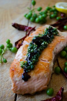 Pan-fried salmon topped with a tangy green sauce and pomegranate molasses.