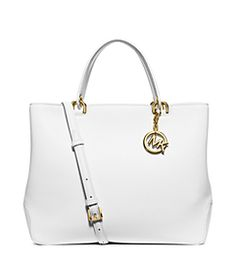 Crafted from soft pebbled leather, this large tote features a spacious silhouette that stows the essentials and more. Carry it by its refined top handles or attach the adjustable shoulder strap for hands-free style. Michael Kors Stores, Handbags Michael Kors, Baseball Wedding Centerpieces, Laid Back Style, Large Tote, Purse Wallet, Pebbled Leather, Shoulder Strap, Tote Bag