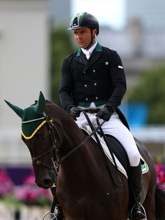 Ruy Fonseca completes first phase of the Eventing competition.  Ruy Fonseca of Brazil riding Tom Bombadill Too competes in the Equestrian Dressage event on Day 2 of the London 2012 Olympic Games at Greenwich Park.