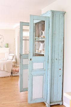 Using chicken wire - instead of glass panes - as antique cupboard doors is aesthetically pleasing. It adds an instant touch of shabby chic to the whole look. #home #decor #blue #closet #wire