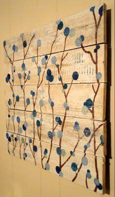 Another great reclaimed lumber or pallet wood idea!  Could be wall art or a headboard.