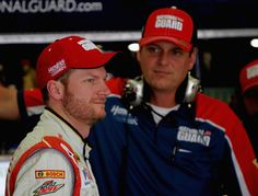 Steve Letarte Photos Photos - Dale Earnhardt Jr., driver of the #88 National Guard Chevrolet, stands in the garage area with his crew chief Steve Letarte during practice for the NASCAR Sprint Cup Series Oral-B USA 500 at Atlanta Motor Speedway on August 29, 2014 in Hampton, Georgia. - Atlanta Motor Speedway: Day 1