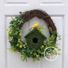 Dress your door with this gorgeous spring wreath. This wreath features fern, ivy, parsley, wildflowers, a moss covered bird house and a yellow burlap bird in yellow and shades of lime, spring and kelly green. Tip to tip measurement is 19W 19L 5D Created on a 18 inch grapevine #birdhousetips