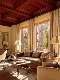 Pair custom silk drapes with woven shades. A great look for these oversized windows.
