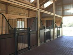 Horse stalls. Love the swing doors and the dark wood. The wood would hide markings. Don't like the actual structure of the stable.
