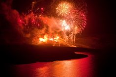 The fireworks show begins to escalate with bright red and orange colors Fire Works, Fireworks Show, Santorini Wedding, Before Sunset, Wedding Locations, Atlantis, Volcano, Orange Color, Greece