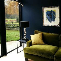 Colorful living room with dark blue walls and green armchair - Decoration For Home Easy Home Decor, Living Room Green, Dark Walls, Interior Design, Dark Blue Walls, Blue Walls, Interior, Green Armchair, Colourful Living Room
