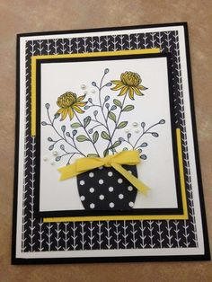 handmade card ... Flowering fields flowers in a vase made with a large oval punch... black and white with pops of yellow .. Stampin' Up!