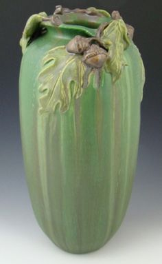 """Ephraim Stalwart Oak Vase, with Story Card $298. From Ephraim Faience's Trees and Leaves Collection comes this majestic vase. Available as shown from Dard Hunter Studios. 12""""h x 5.75""""w. Comes with a Story Card from Ephraim, describing the artist's inspiration for the vase."""