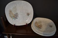 """Vintage J&G Meakin England Porcelain Rock Fern 4 Square Dinner Plates & 2 side (salad) plates  Gorgeous vintage 1950s J&G Meakin England pottery porcelain 4 square plates with curve corners Pattern is Rock Fern Green and brown ferns on grey background 4 Plates measures 9¾""""sq each 2 Side Plates are approx 6"""" each In excellent condition with no chips, cracks, crazing or wear For the exception very minor utensil marks barely notice http://toronto.craigslist.ca/yrk/atq/5001595235.html"""