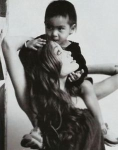 I just love her and from many photos of her with her children, she seems to have fun, laugh and enjoy them immensely.