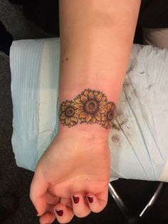 24 Sunflower tattoo ideas (On ankle or wrist, small yellow sunflower with words You are my Sunshine and/or Close to Gold)