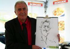 Karikaturist   Portraitszeichner auf ihrem Messestand