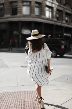SUNDOWNER | Fiona from thedashingrider.com wears Faithfull The Brand Tunic, Set Shorts, a Catarzi Hat, Loeffler Randall Espadrilles and a Saint Laurent Bag | The full look is available here: http://liketk.it/2oHdz
